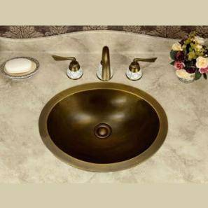 A bathroom sink made of Bronze material